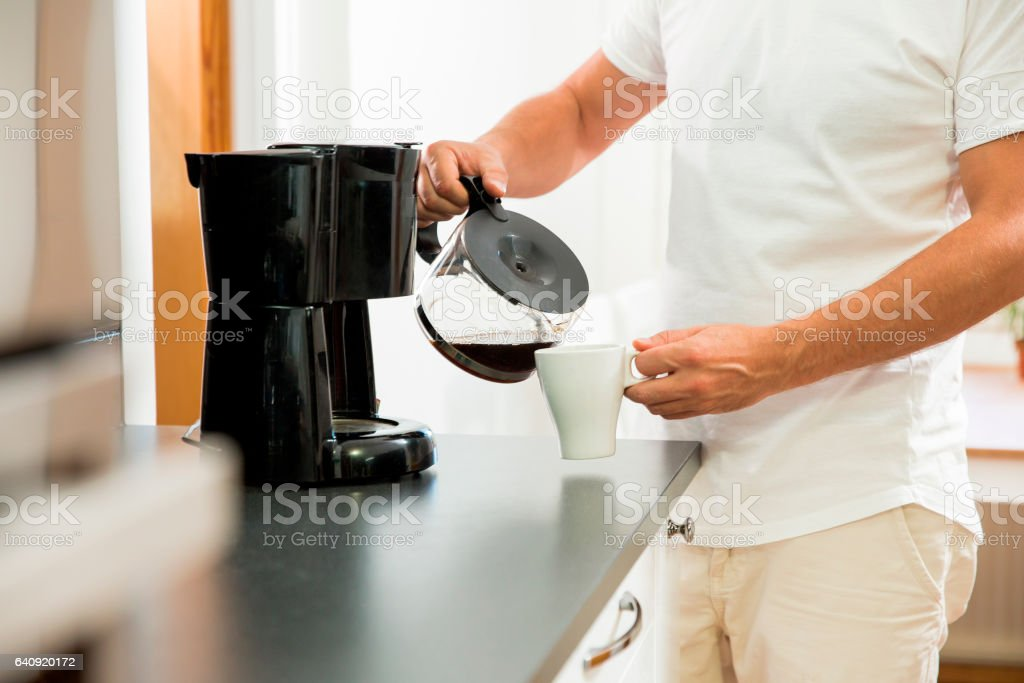 Man drinking coffee in the morning stock photo