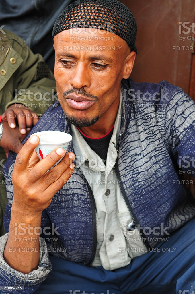 Man drinking Ethiopian coffee in Addis Ababa stock photo