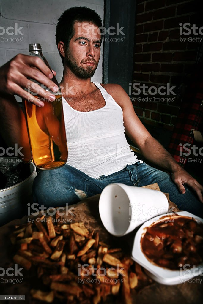 Man Drinking Forty with Fast Food royalty-free stock photo