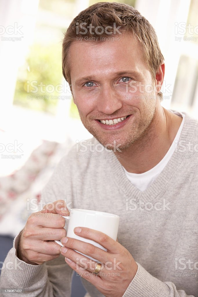 Man drinking from cup royalty-free stock photo