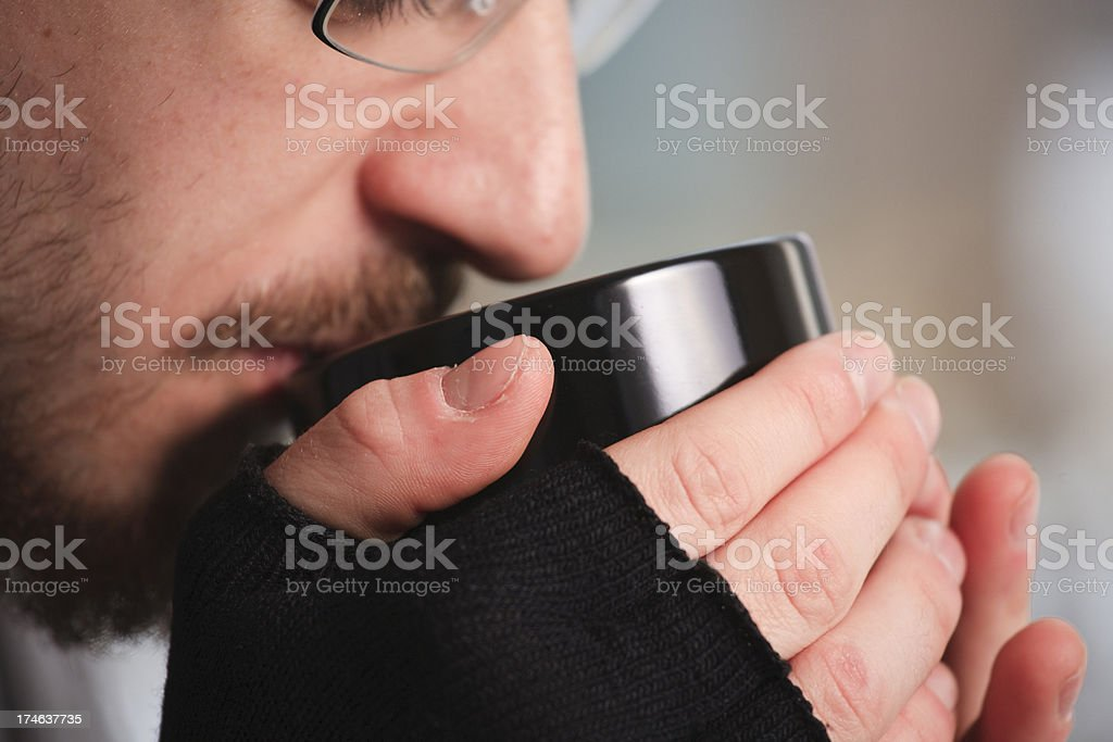 Man drinking from hot coffee cup royalty-free stock photo