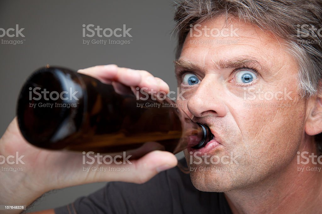 man drinking from the bottle stock photo