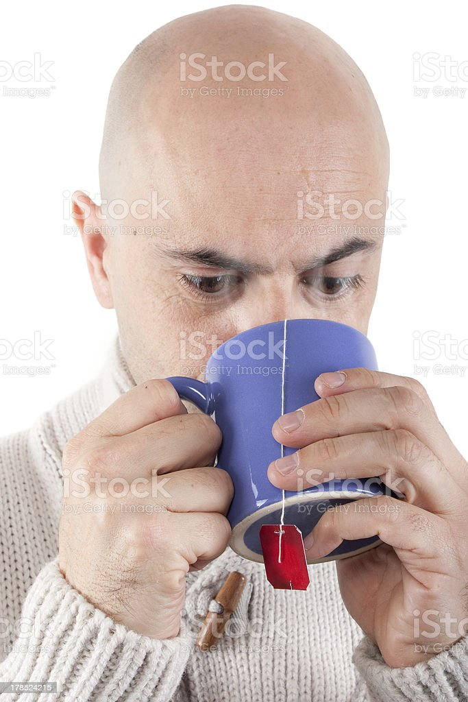 Man drinking hot drink in a mug. royalty-free stock photo