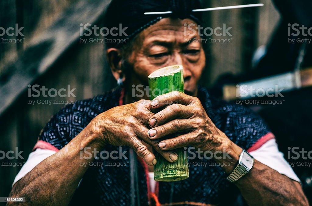Man drinking local wine-India. stock photo