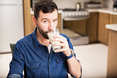 Man drinking milk from a glass