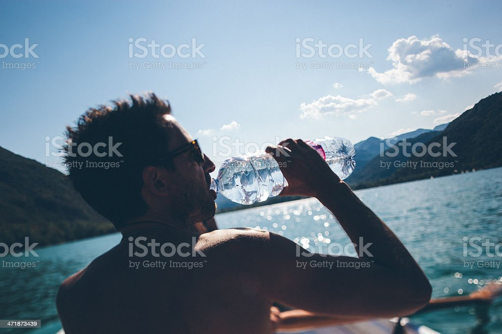 Man Drinking on a boat royalty-free stock photo