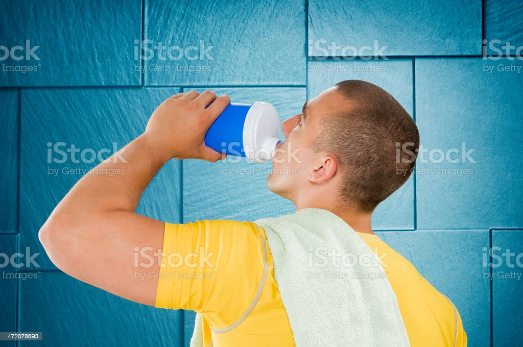 Man drinking protein drink royalty-free stock photo