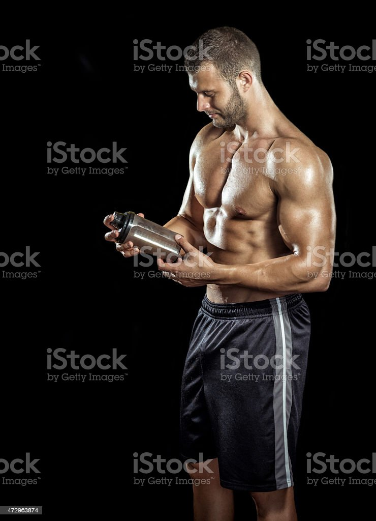 Man drinking protein shake stock photo