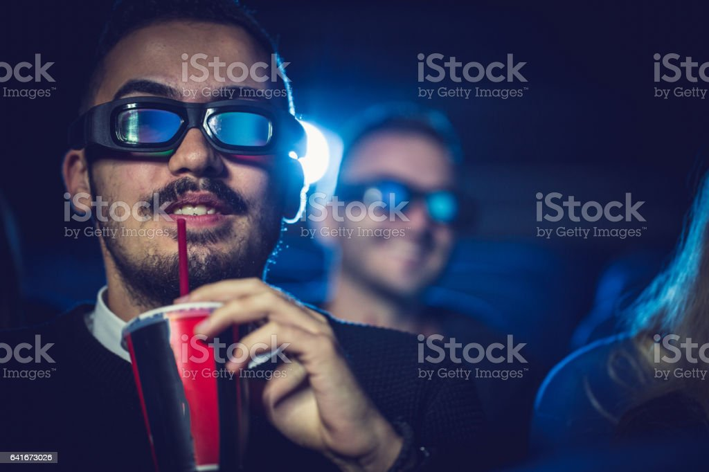 Man drinking soda in cinema stock photo