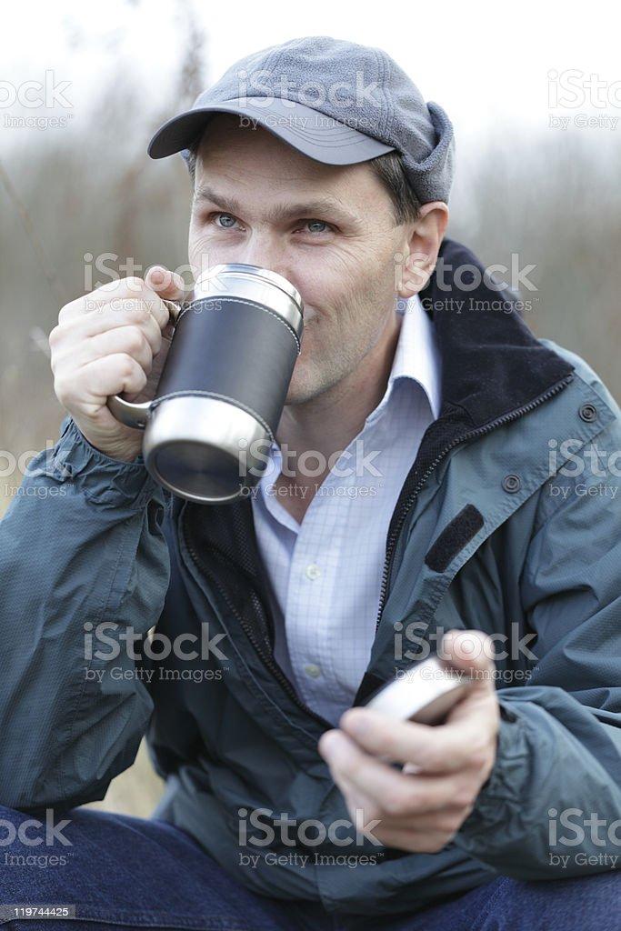 Man drinking tea outdoors royalty-free stock photo