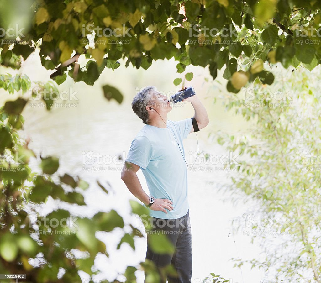 Man drinking water after exercise royalty-free stock photo