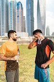 Man drinking water after run in Dubai