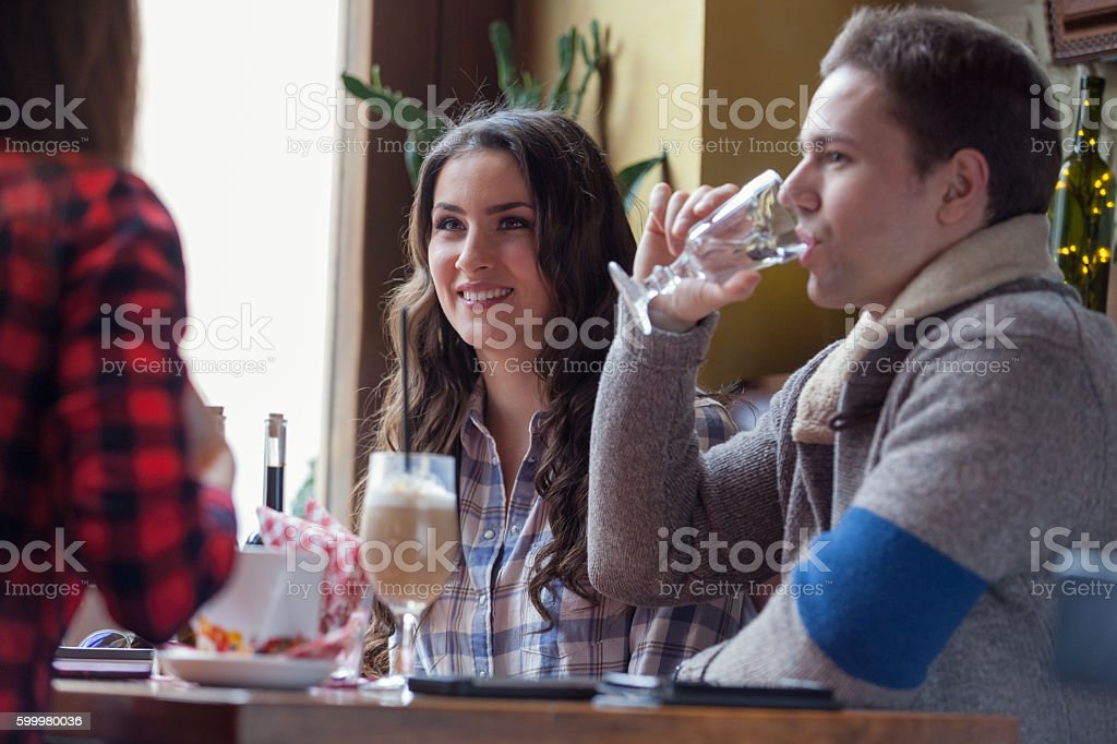 Man drinking water in cafe stock photo
