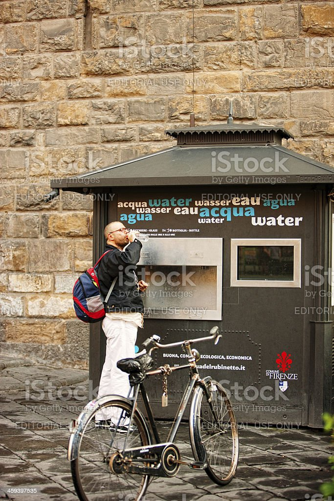Man drinking water on Piazza della Signoria, Florence, Italy royalty-free stock photo