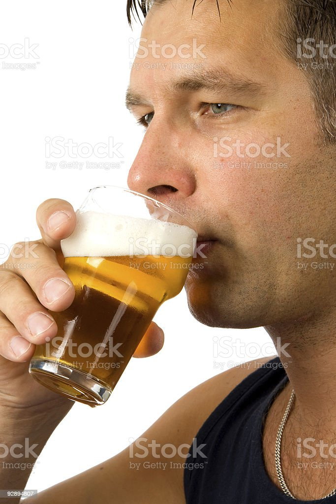 Man drinks beer stock photo