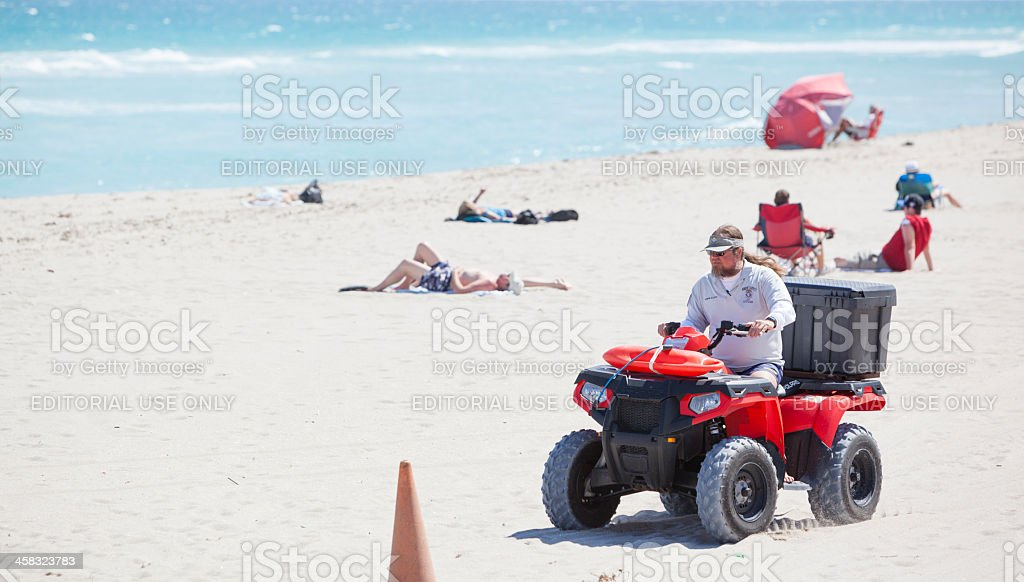 Man drive ATV on the beach royalty-free stock photo