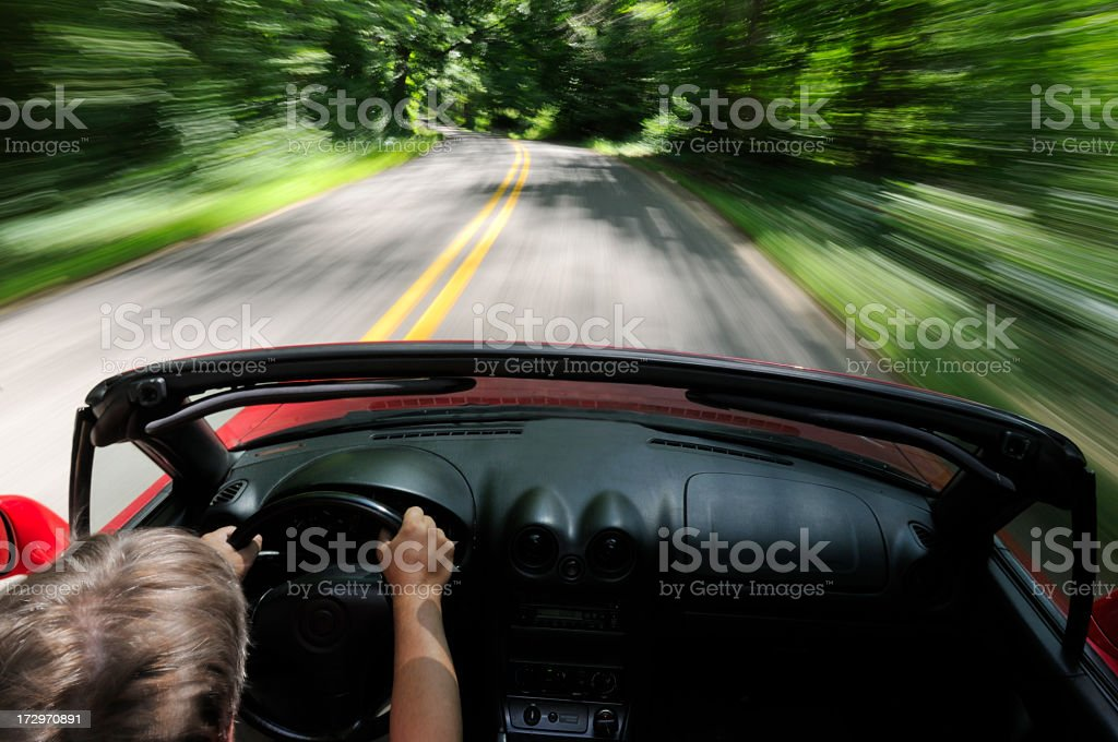 Man driving a convertible in a scenic road royalty-free stock photo