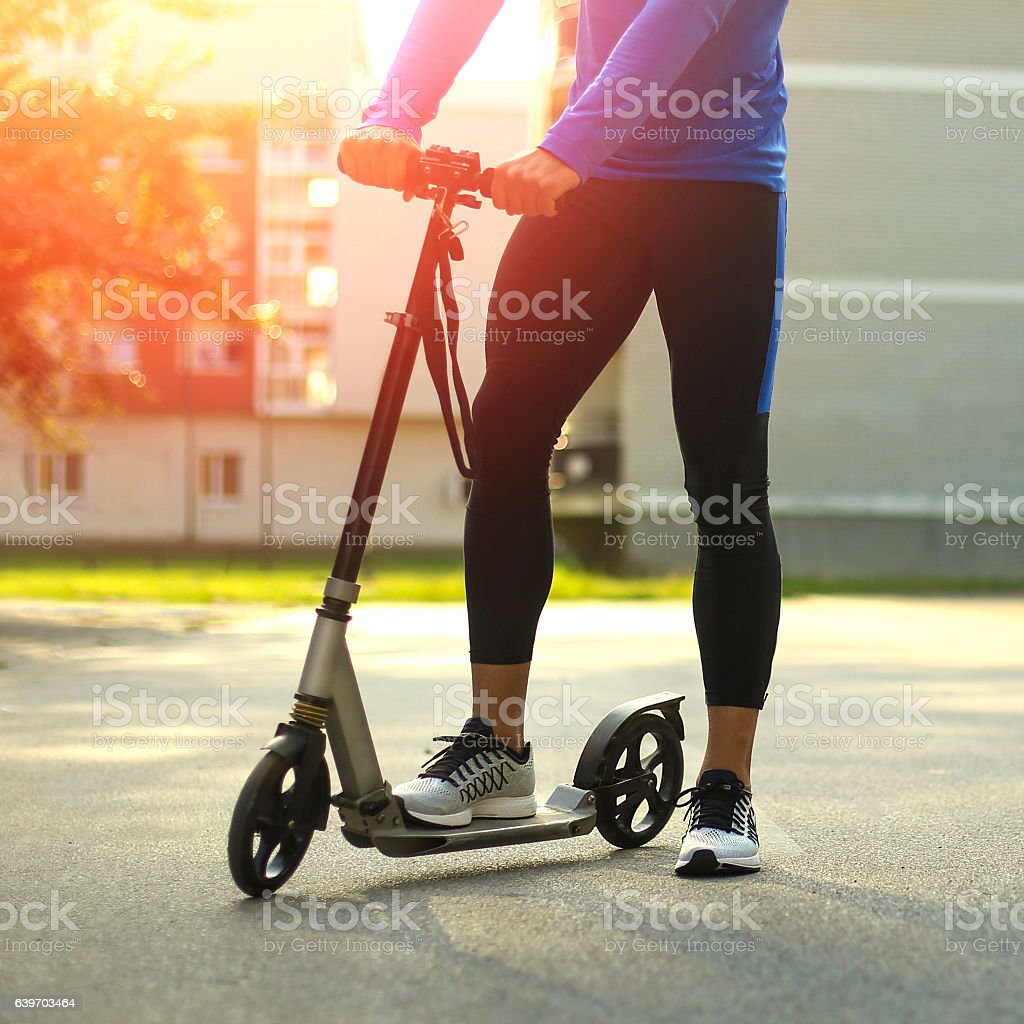 Man driving a scooter stock photo