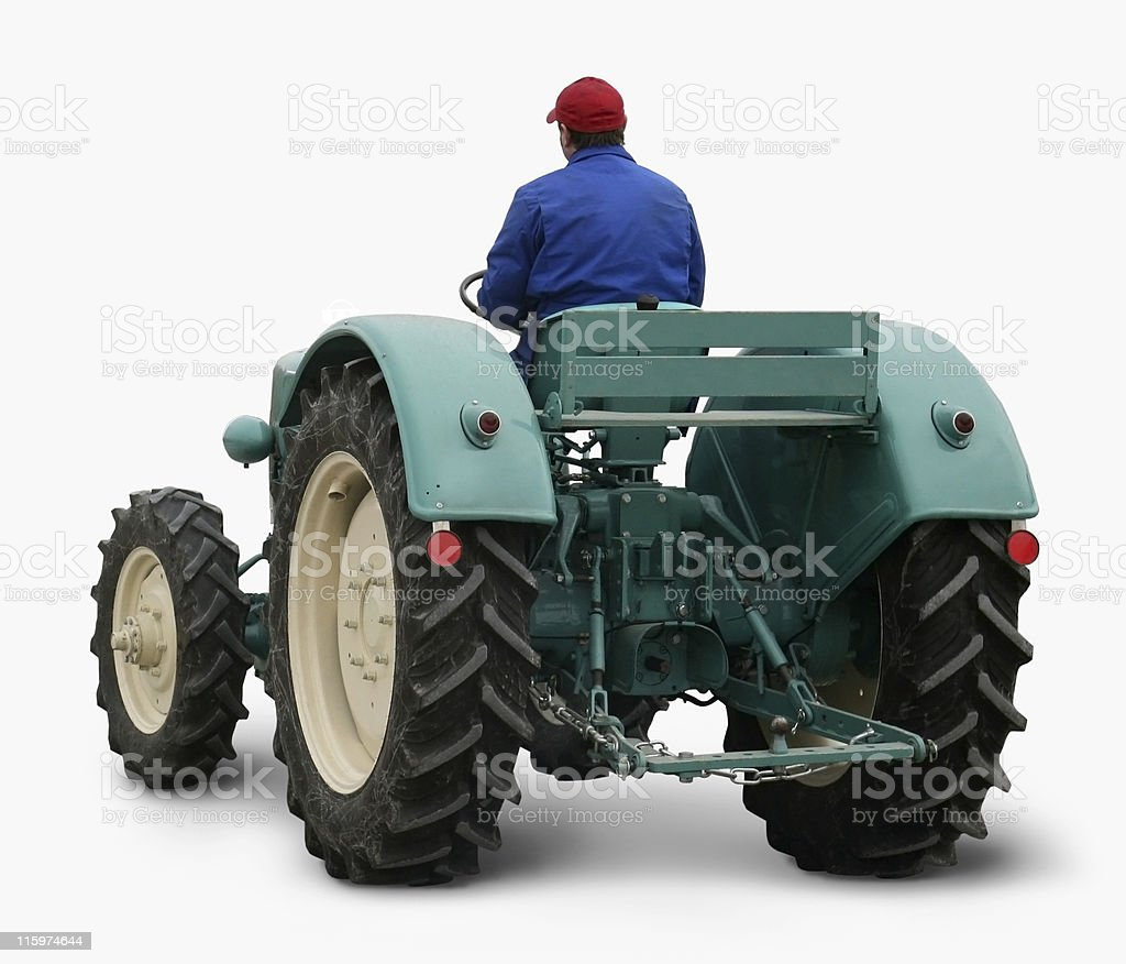 man driving a tractor royalty-free stock photo