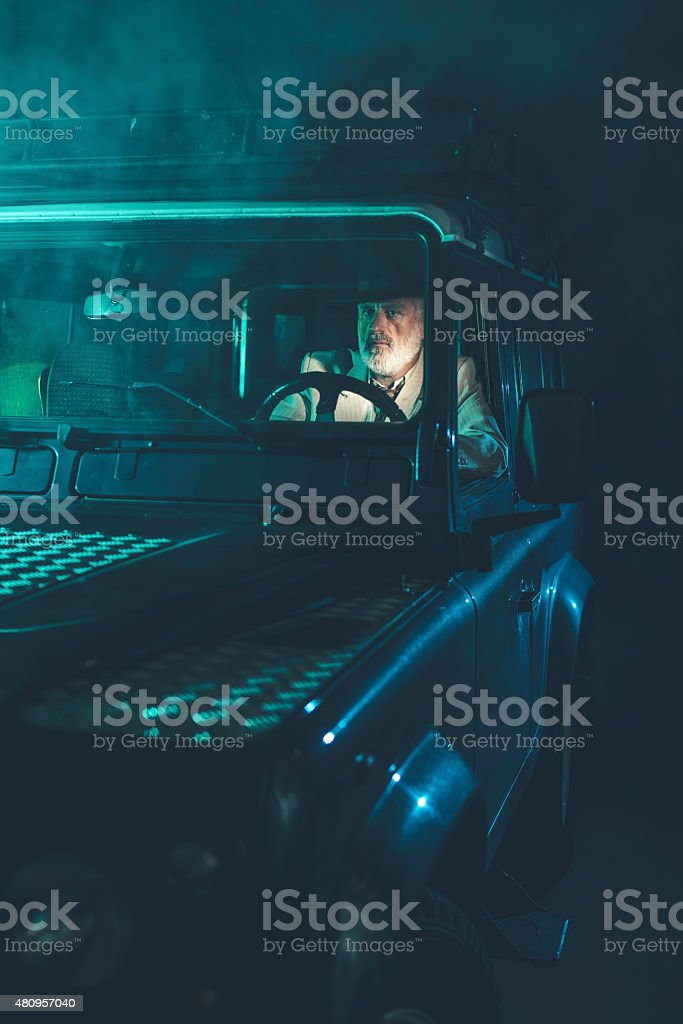 Man Driving Alone in the Middle of the Night stock photo