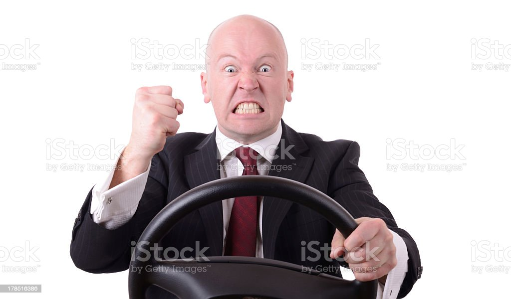 Man driving and experiencing road rage stock photo
