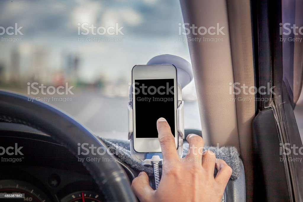 Man driving and using phone in car stock photo