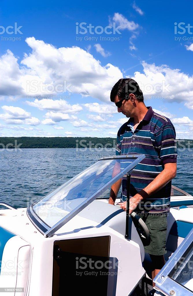 Man Driving Boat royalty-free stock photo