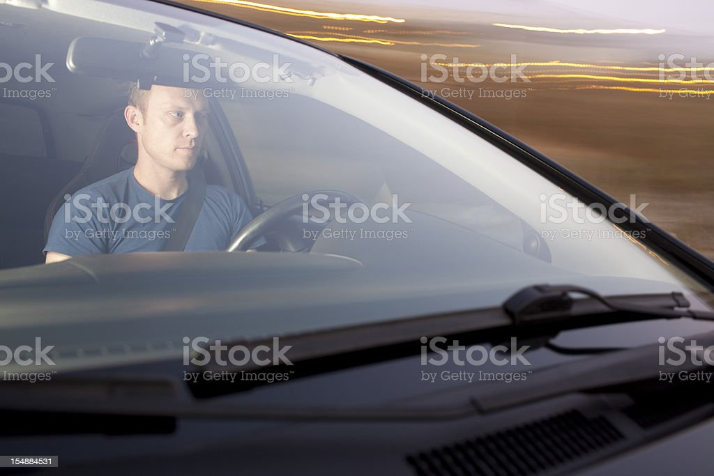 Man driving car in motion. royalty-free stock photo