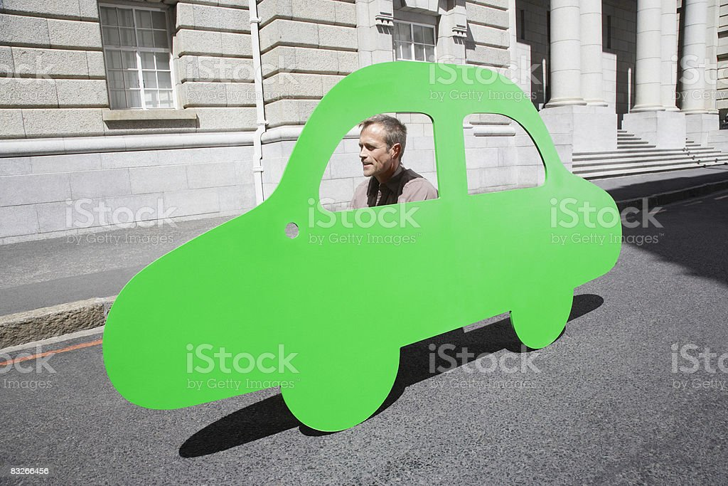 Man driving car outline on urban roadway stock photo