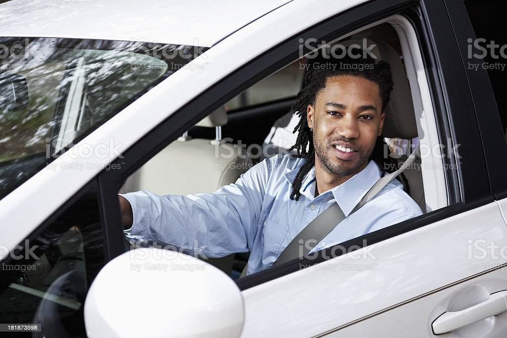 Man driving car stock photo
