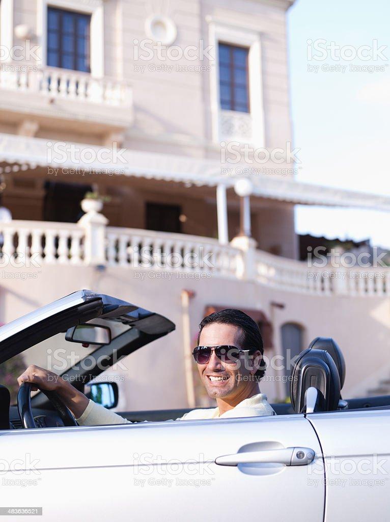 Man driving convertible stock photo