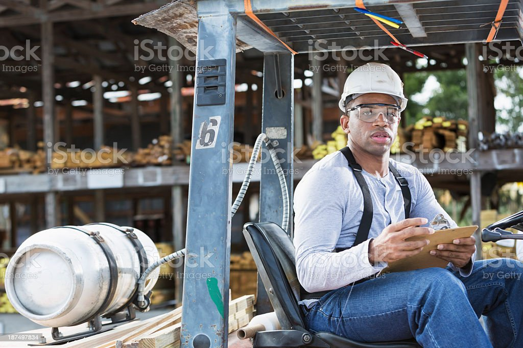 Man driving forklift royalty-free stock photo