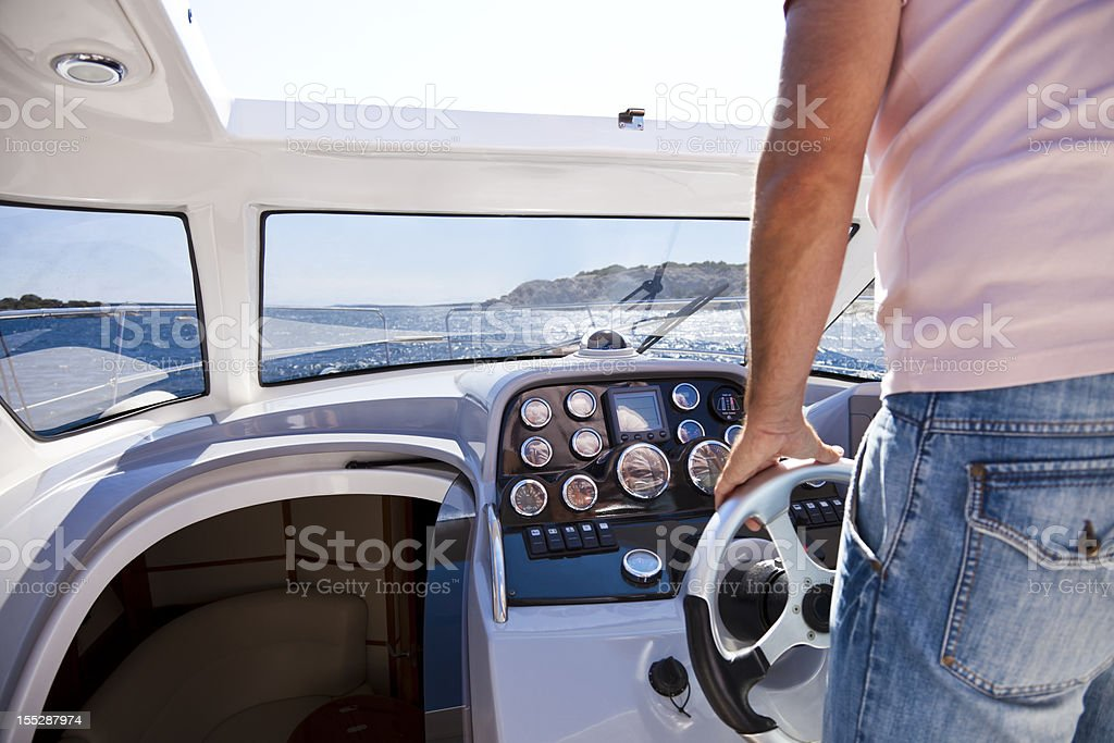 Man driving motorboat stock photo