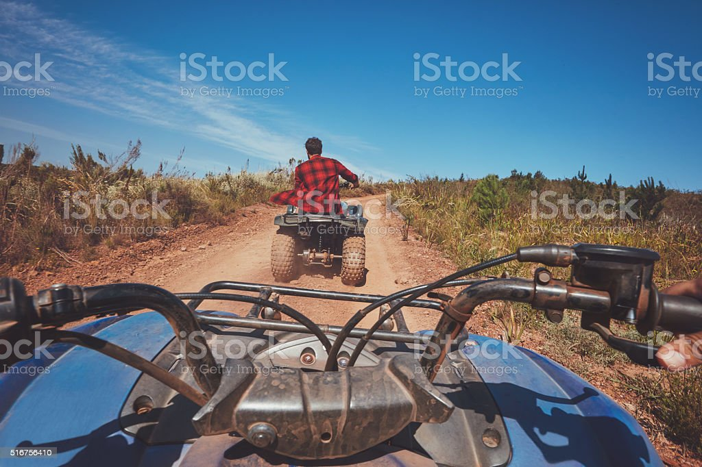 Man driving off road on an ATV stock photo