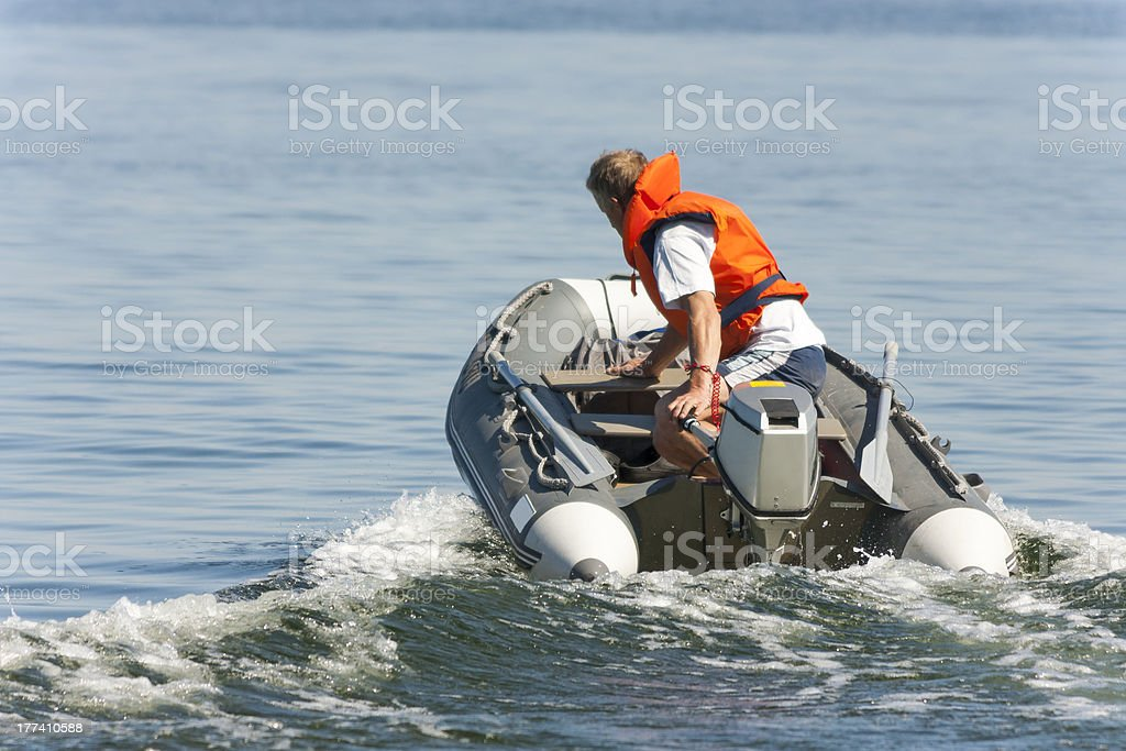 Man driving on a boat royalty-free stock photo