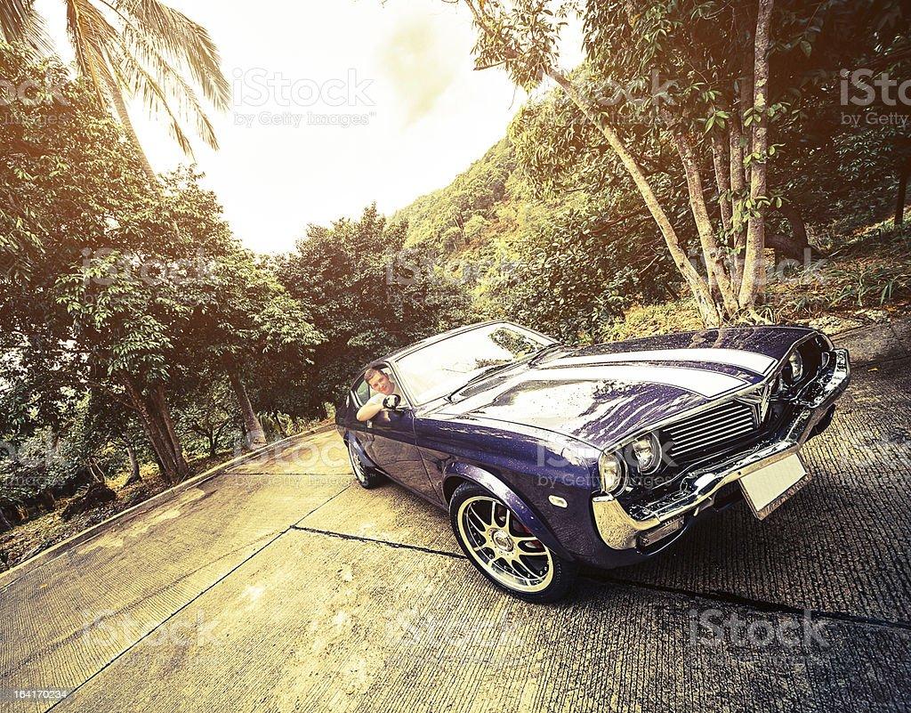Man driving retro car royalty-free stock photo