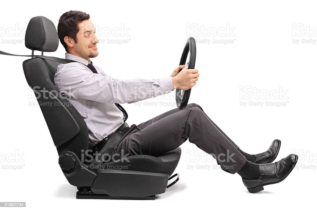 Man driving seated on a car seat stock photo