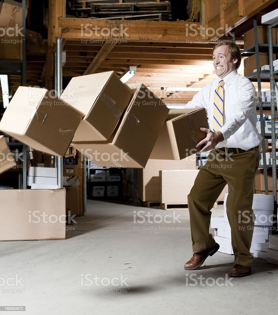 Man Dropping Boxes stock photo