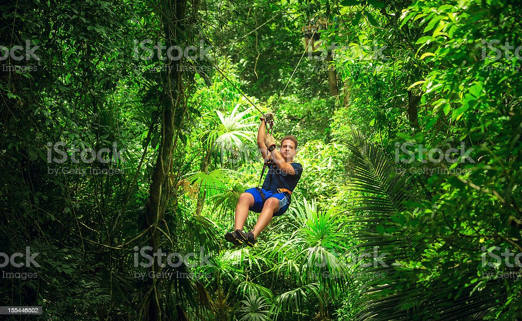 man during a Zip-line Tour Guatemala stock photo