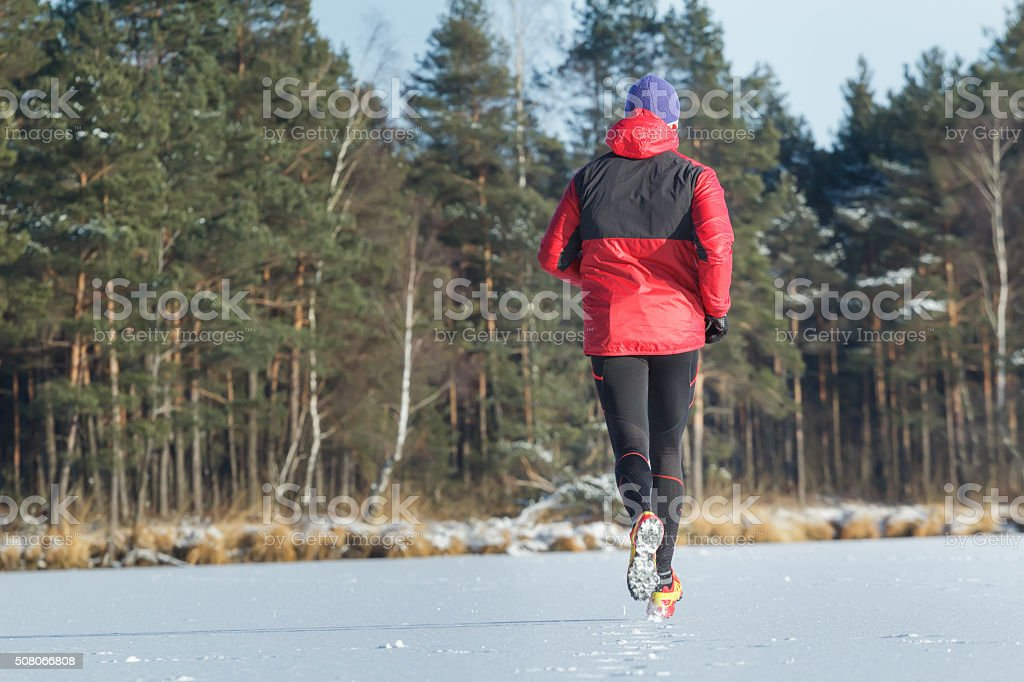 Man during sport trail running race in winter outdoor stock photo