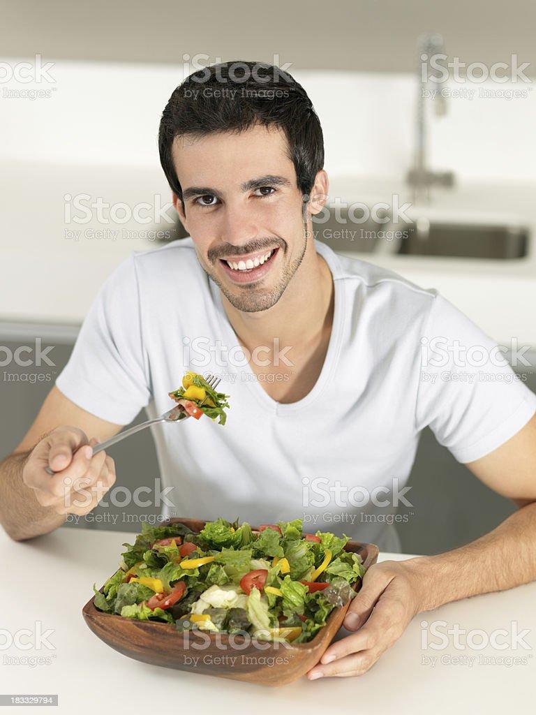 Man eating a big salad royalty-free stock photo