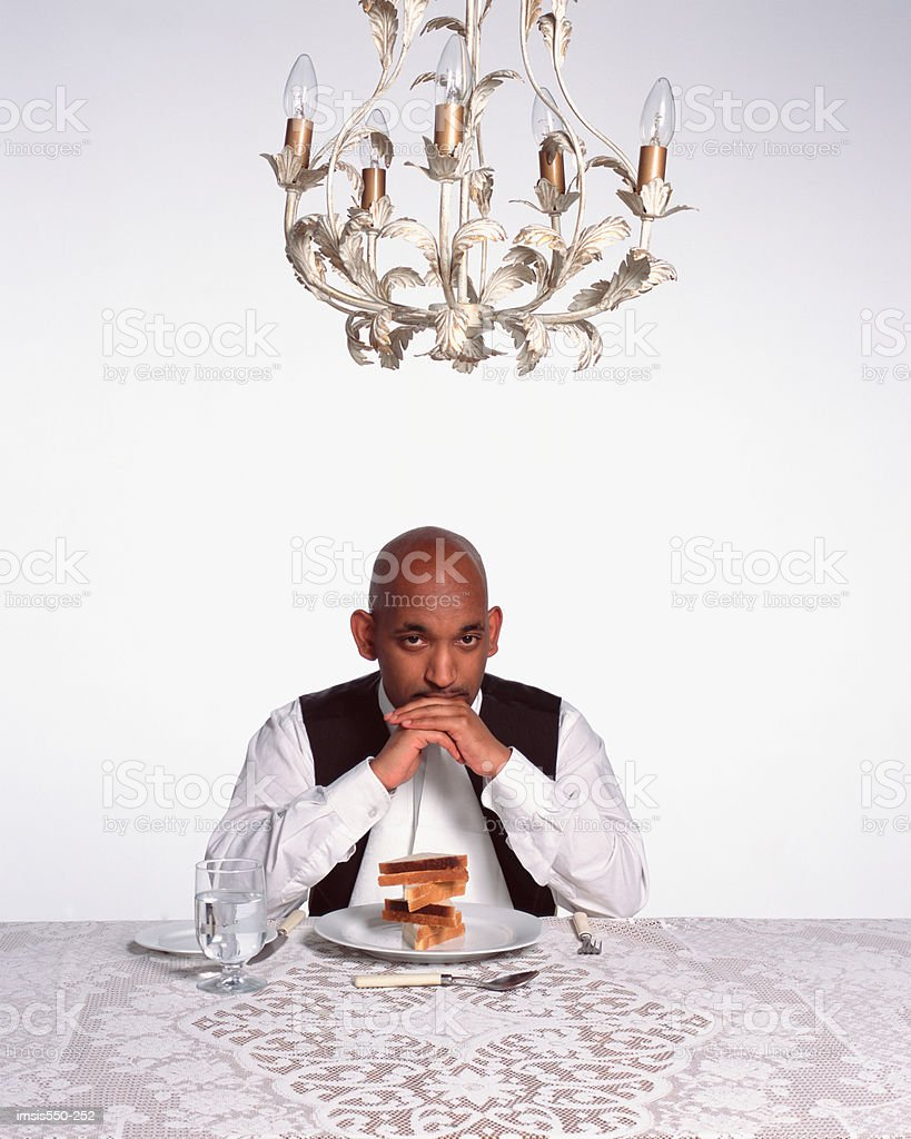 Man eating at an elegantly laid table stock photo