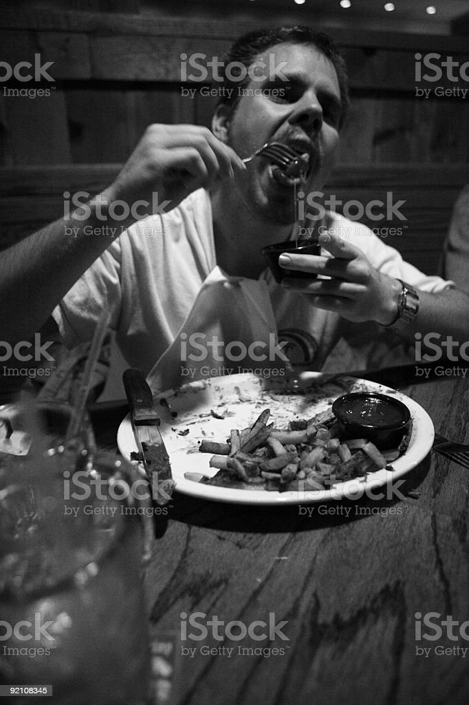 Man Eating At Dinner Table. royalty-free stock photo
