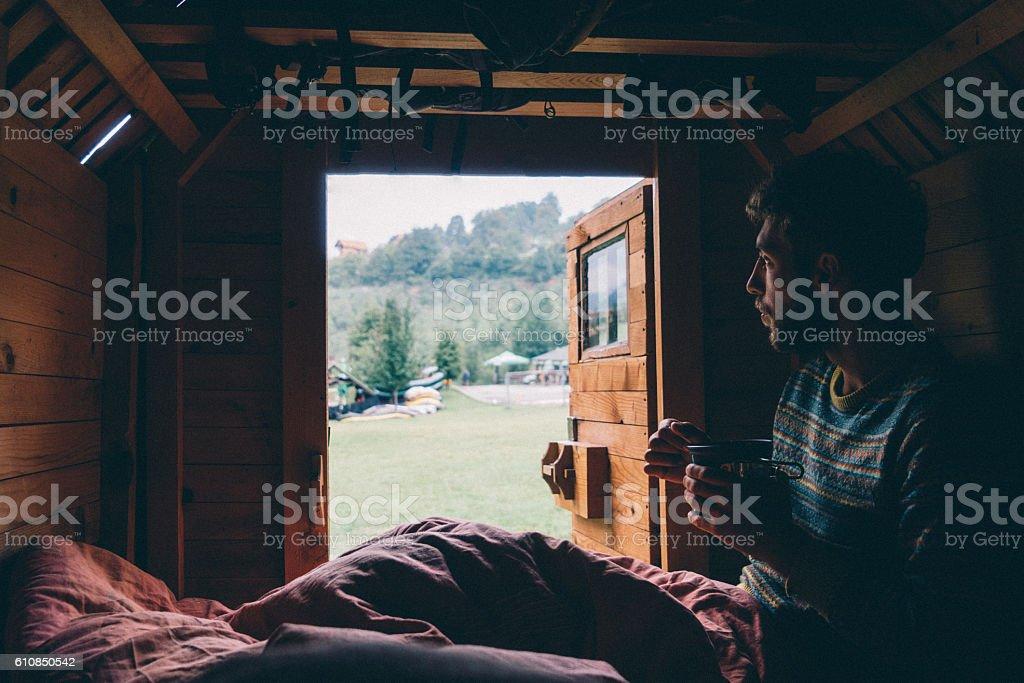 Man eating breakfast in tiny house stock photo