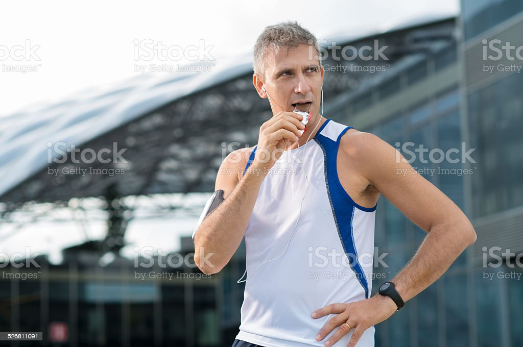 Man Eating Energy Bar stock photo