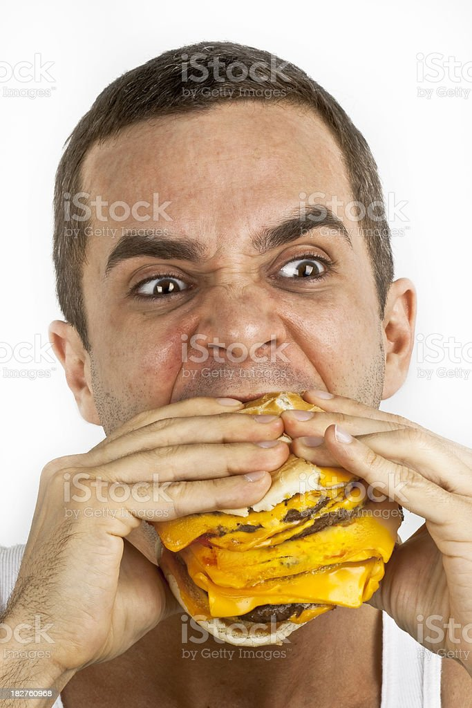 Man eating Giant Portions of Fast Food royalty-free stock photo