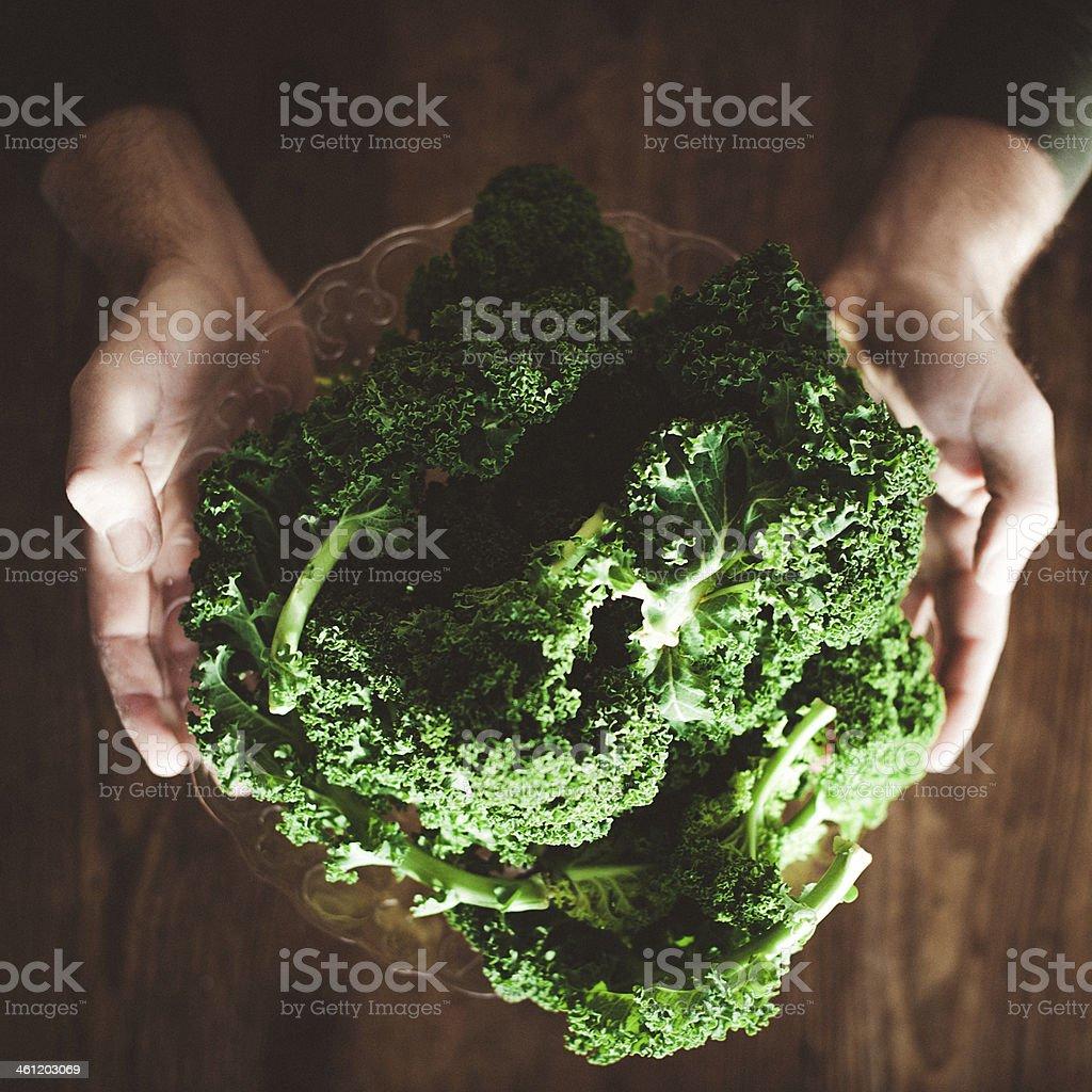 Man eating green kale stock photo