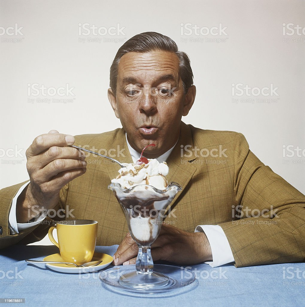 Man eating ice cream stock photo