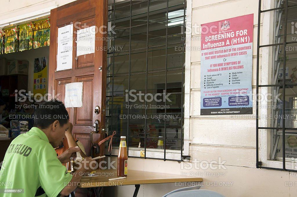 Man eating in a restaurant. stock photo