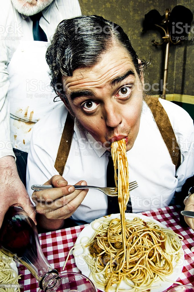 Man Eating Large Plate of Spaghetti royalty-free stock photo